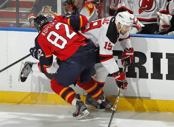 SUNRISE, FL - APRIL 21: Tomas Kopecky #82 of the Florida Panthers checks Petr Sykora #15 of the New Jersey Devils in Game Five of the Eastern Conference Quarterfinals during the 2012 NHL Stanley Cup Playoffs at the BankAtlantic Center on April 21, 2012  in Sunrise, Florida. The Panthers defeated the Devils 3-0. (Photo by Joel Auerbach/Getty Images)