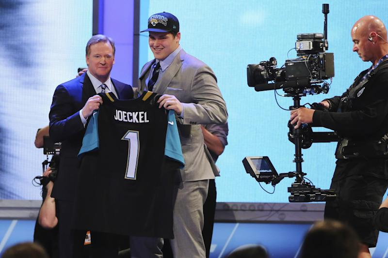 Luke Joeckel, from Texas A&M, stands with NFL Commissioner Roger Goodell after being selected second overall by the Jacksonville Jaguars in the first round of the NFL football draft, Thursday, April 25, 2013, at Radio City Music Hall in New York. (AP Photo/Mary Altaffer)