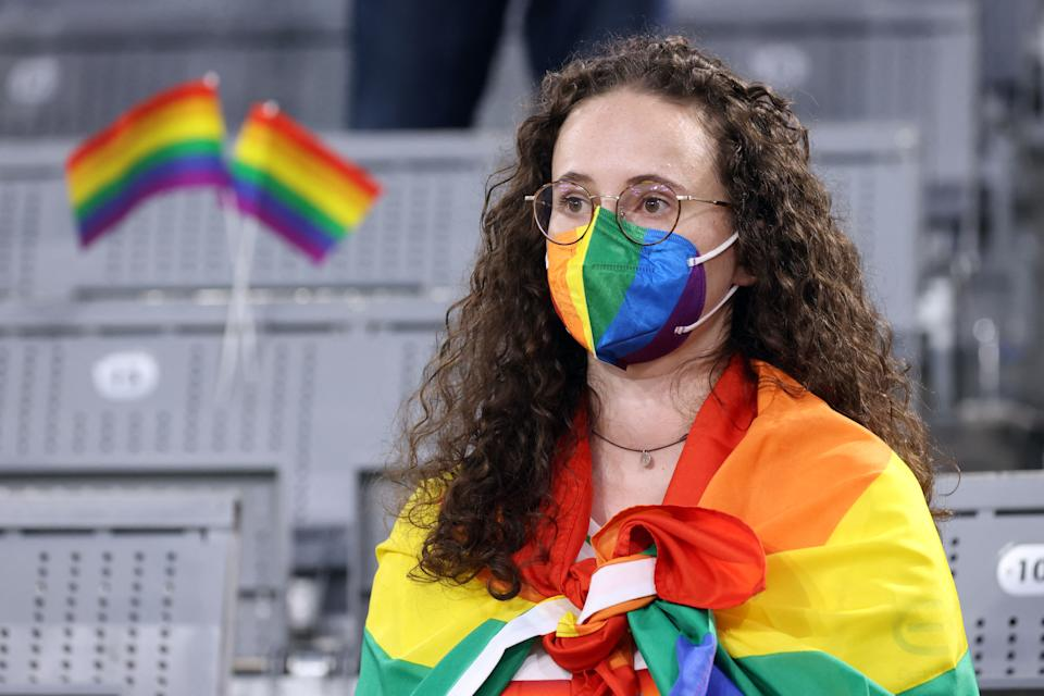A fan wrapped in a Rainbow Flag waits for the start of the UEFA EURO 2020 Group F football match between Germany and Hungary at the Allianz Arena in Munich on June 23, 2021. (Photo by ALEXANDER HASSENSTEIN / POOL / AFP) (Photo by ALEXANDER HASSENSTEIN/POOL/AFP via Getty Images)