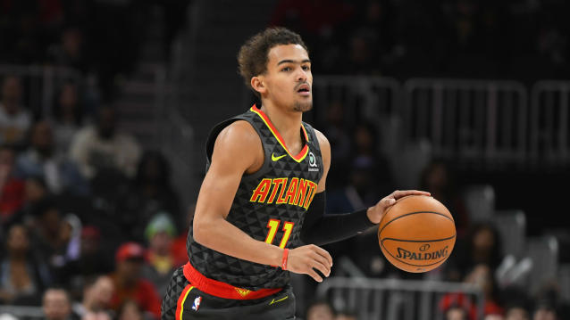 Atlanta Hawks guard Trae Young (11) dribbles upcourt during an NBA basketball game against the Charlotte Hornets, Monday, March 9, 2020, in Atlanta. (AP Photo/John Amis)
