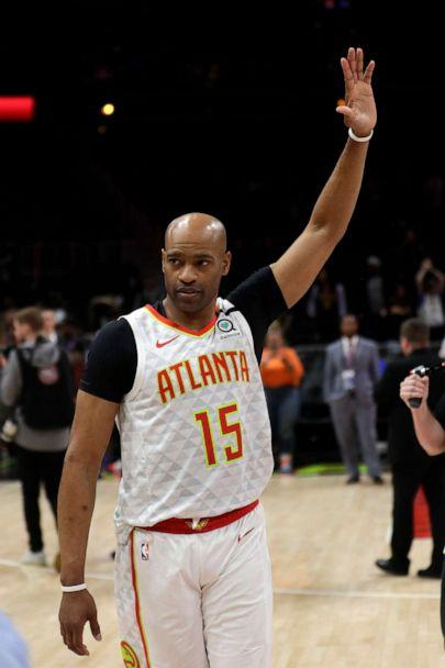 PHOTO: Atlanta Hawks guard Vince Carter (15) wavs to the crowd as he leaves the court following an NBA basketball game against the New York Knicks Wednesday, March 11, 2020, in Atlanta.  (John Bazemore/AP)