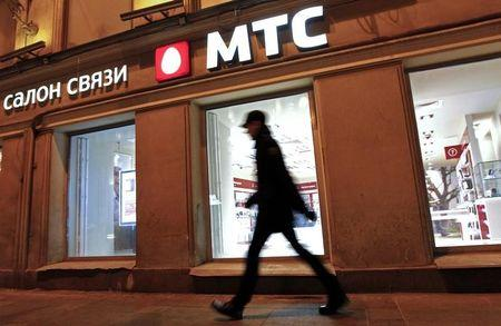 A man walks past a MTS shop in St.Petersburg