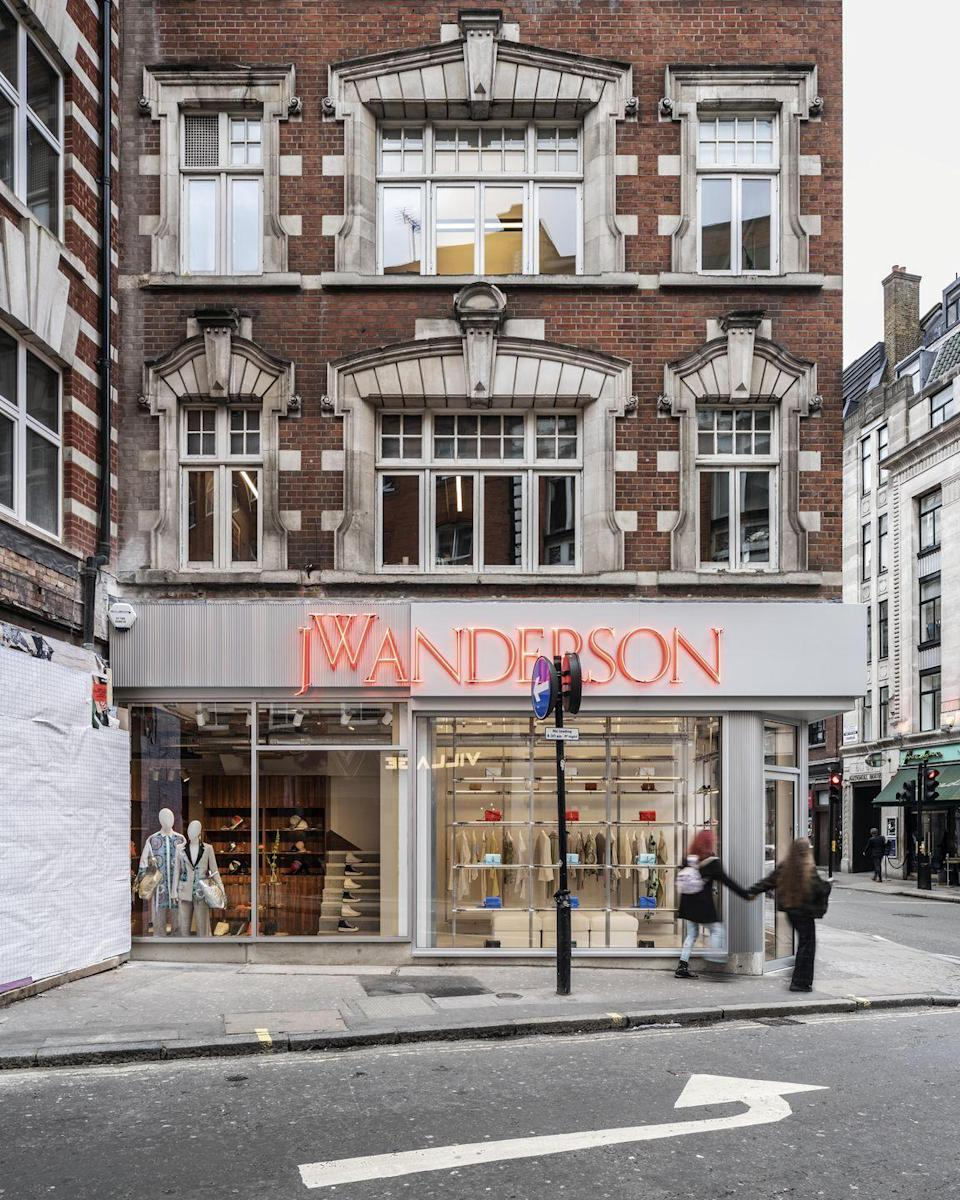 """<p>Jonathan Anderson has been a central figure in fashion since he launched his eponymous brand in 2008 - more so since he took the creative reins at luxury, LVMH-owned brand LOEWE in 2013.</p><p>Now, Anderson has fittingly opened his first JW Anderson flagship store in the centre of London, occupying a two-storey space that sits squarely between Soho's most famous streets: Brewer Street and Wardour Street.</p><p>The culturally significant site is steeped in London's history as a melting-pot of creativity and culture, simultaneously the haunt of esteemed artists and the city's darker underbelly. 'You have this beautiful balance of high and low culture here which is incredibly important,' he told <a href=""""https://www.theguardian.com/fashion/2020/mar/13/jw-anderson-queer-culture-has-an-incredible-history-in-soho"""" rel=""""nofollow noopener"""" target=""""_blank"""" data-ylk=""""slk:The Guardian"""" class=""""link rapid-noclick-resp"""">The Guardian</a> this week.</p><p>That combination of the subversive, chic and tongue-in-cheek is a USP of Anderson's, evident in his witty take on tradition and luxury. Which you can see for yourself in the space with its flashy neon exterior, akin to that of the casino next door, and the indisputably classy mahogany panelling inside. Oh, and <a href=""""https://go.redirectingat.com?id=127X1599956&url=https%3A%2F%2Fwww.ln-cc.com%2Fen%2Fprivate-sale-aw19%2Fpenis-keychain-in-orange-jwa0136011kha.html&sref=https%3A%2F%2Fwww.elle.com%2Fuk%2Ffashion%2Fg31095508%2Findustry-update%2F"""" rel=""""nofollow noopener"""" target=""""_blank"""" data-ylk=""""slk:these shocking accessories"""" class=""""link rapid-noclick-resp"""">these shocking accessories</a>, which you can find alongside Anderson's signature runway looks. </p><p>Beats the contents of our local corner shop...<a href=""""https://www.jwanderson.com/gb"""" rel=""""nofollow noopener"""" target=""""_blank"""" data-ylk=""""slk:"""" class=""""link rapid-noclick-resp""""><br></a></p><p><a href=""""https://www.jwanderson.com/gb"""" rel=""""nofollow noopener"""" target=""""_blank"""" data-ylk"""