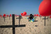 A thousand red balloons were released during a tribute to COVID-19 victims organized by an NGO at the Copacabana beach in Rio de Janeiro on August 08, 2020