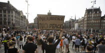 People take part in a Black Lives Matter protest on Dam Square in Amsterdam, Netherlands, Monday, June 1, 2020, to protest against the recent killing of George Floyd, a black man who died in police custody in Minneapolis, U.S.A., after being restrained by police officers on Memorial Day. (AP Photo/Peter Dejong)
