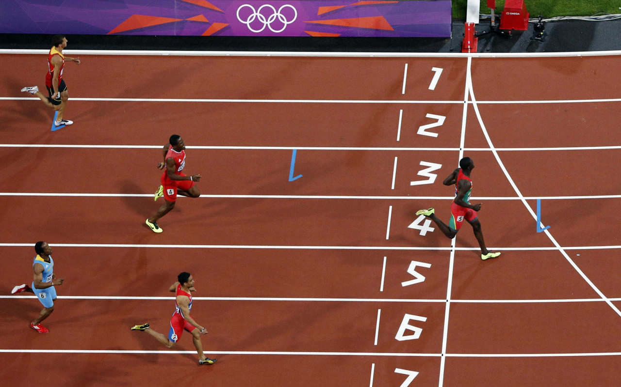 Grenada's Kirani James crosses the finish line to win the men's 400m final at the London 2012 Olympic Games at the Olympic Stadium August 6, 2012. REUTERS/Pawel Kopczynski (BRITAIN  - Tags: OLYMPICS SPORT ATHLETICS)