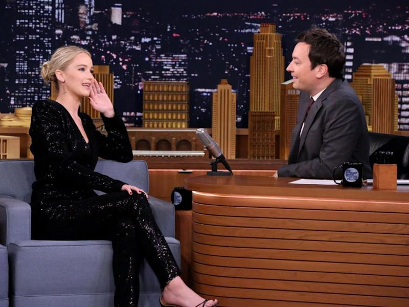 Jennifer Lawrence challenged Jimmy Fallon to an axe throwing contest. Source: Getty