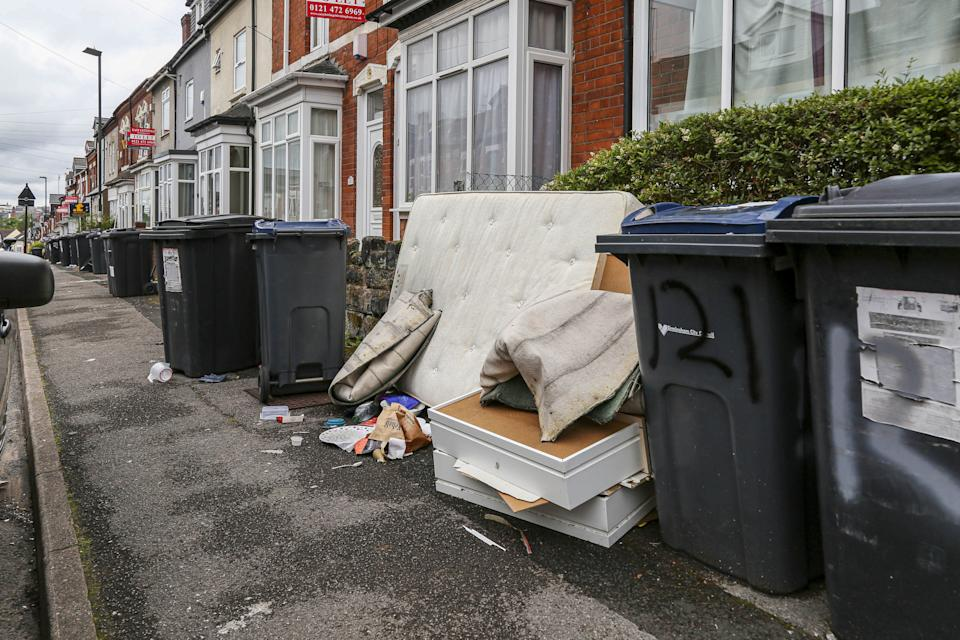 Shocking pictures show tons of rubbish dumped on area nicknamed 'Smelly Oak' by students as they head home for the summer. (SWNS)