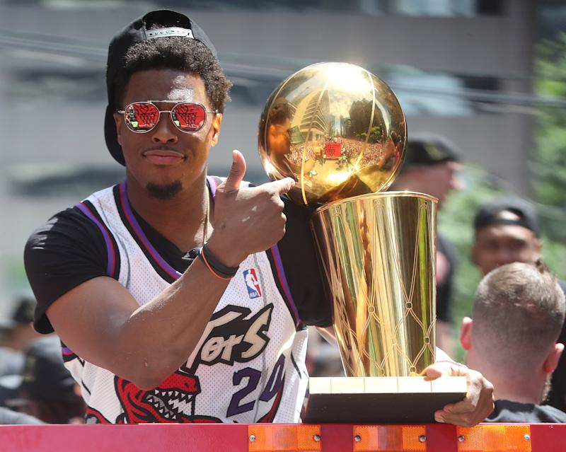 TORONTO, ON- JUNE 17 - Kyle Lowry with the Larry O'Brien NBA Championship Trophy as the Toronto Raptors hold their victory parade after beating the Golden State Warriors in the NBA Finals in Toronto. June 17, 2019. (Steve Russell/Toronto Star via Getty Images)