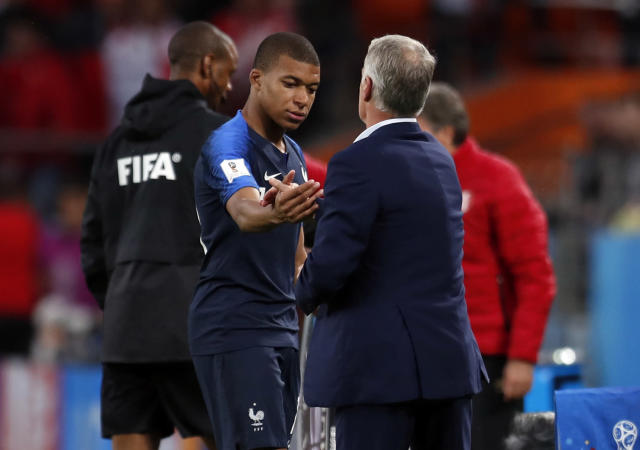 France's Kylian Mbappe, center, is greeted by France head coach Didier Deschamps after he was replaced during the group C match between France and Peru at the 2018 soccer World Cup in the Yekaterinburg Arena in Yekaterinburg, Russia, Thursday, June 21, 2018. (AP Photo/Natacha Pisarenko)
