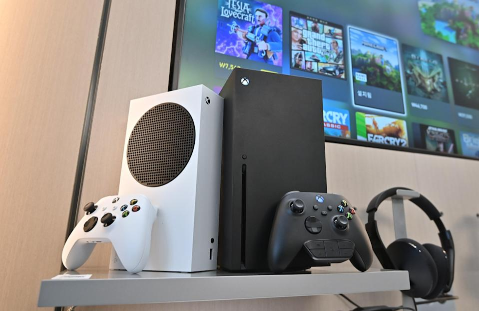 Microsoft's Xbox Series X (black) and series S (white) gaming consoles are displayed at a flagship store of SK Telecom in Seoul.