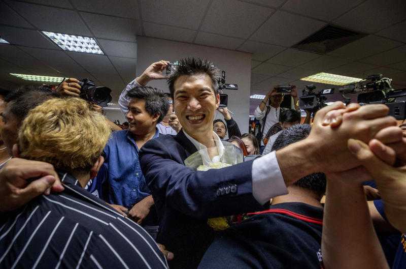 In this Jan. 21, 2020, photo, Future Forward Party leader Thanathorn Juangroongruangkit, center, shakes hands of his supporters at the party's headquarters in Bangkok, Thailand. Thailand's Constitutional Court on Friday, Feb. 21 ordered the popular opposition Future Forward Party dissolved, declaring that it violated election law by accepting a loan from its leader. The court also imposed a 10-year ban on the party's executive members holding political office. (AP Photo/Sakchai Lalit)