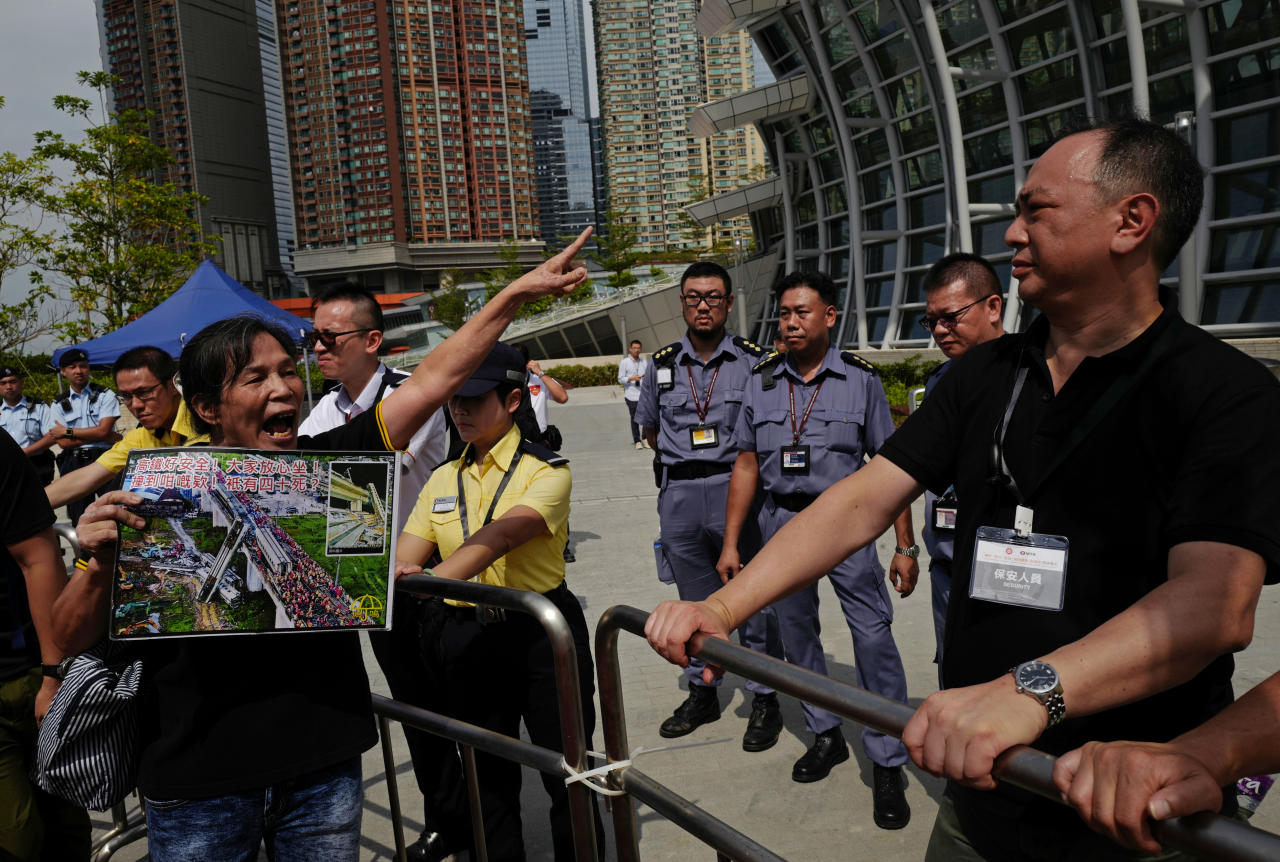 <p> A woman shouts slogans during a protest outside the Western Kowloon Station against the opening ceremony of the Hong Kong Express Rail Link in Hong Kong, Saturday, Sept. 22, 2018. Hong Kong has opened a new high-speed rail link to inland China that will vastly decrease travel times but which also raises concerns about Beijing's creeping influence over the semi-autonomous Chinese region. (AP Photo/Vincent Yu) </p>