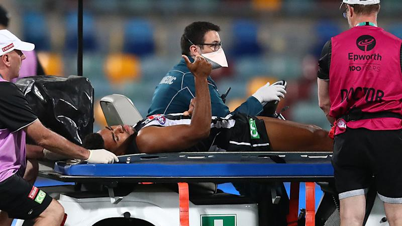 Pictured here, Isaac Quaynor gives the thumbs up as he is stretchered off the field.