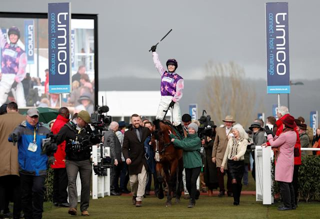 Horse Racing - Cheltenham Festival - Cheltenham Racecourse, Cheltenham, Britain - March 16, 2018 Bridget Andrews on Mohaayed celebrates after winning the 14.10 Randox Health County Handicap Hurdle Action Images via Reuters/Andrew Boyers