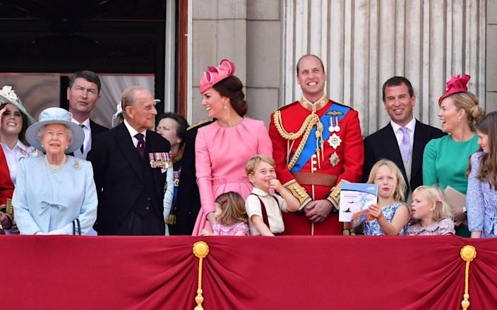 Princess Eugenie, Queen Elizabeth, Vice Admiral Timothy Laurence, Prince Philip, Duchess of Cambridge, Princess Charlotte, Prince George, Prince William, Savannah Phillips, Peter Phillips, Isla Phillips and Autumn Phillips at Buckingham Palace during the Trooping the Colour parade, 2017  - James Devaney /WireImage