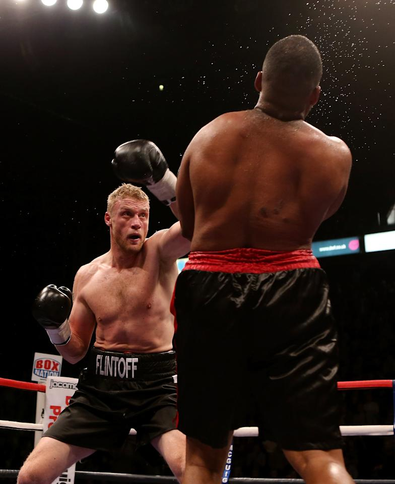 MANCHESTER, ENGLAND - NOVEMBER 30:  Andrew Flintoff in action with Richard Dawson during their International Heavyweight bout at MEN Arena on November 30, 2012 in Manchester, England.  (Photo by Scott Heavey/Getty Images)