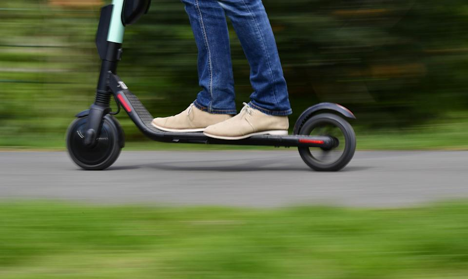 <p>The government is trialing an e-scooter rental scheme in cities across the UK</p> (AFP via Getty Images)