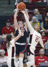 Gonzaga's Melody Kempton, center, rebounds between Stanford's DiJonai Carrington, right, and Lacie Hull during the first half of an NCAA college basketball game Sunday, Nov. 17, 2019, in Stanford, Calif. (AP Photo/George Nikitin)