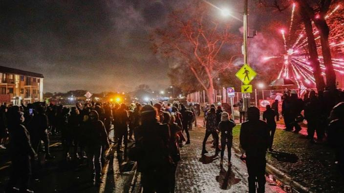 On April 12, 2021, the day after Daunte Wright was shot dead by police officers, protesters threw fireworks at police outside the Brooklyn Center Police Station.