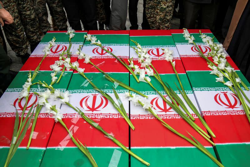 The coffins of the four Iranian victims of the Ukrainian plane crash in Iran, are seen during their funeral ceremony in Hamadan