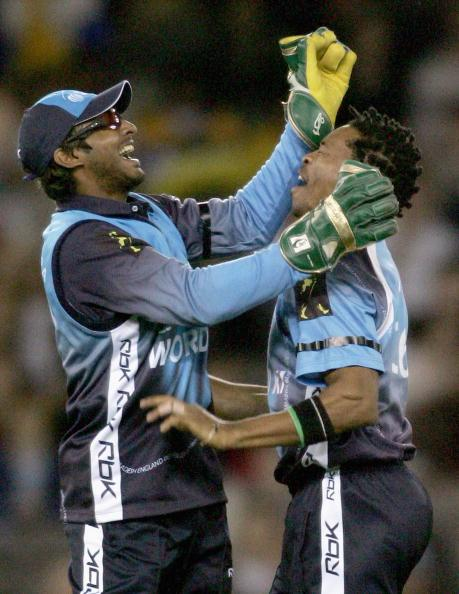 MELBOURNE, AUSTRALIA - OCTOBER 09:  Kumar Sangakkara and Makhaya Ntini of the ICC World XI celebrate a wicket during game three of the Johnnie Walker Super Series  between Australia and the ICC World XI at the Telstra Dome October 9 2005 in Melbourne, Australia.  (Photo by Ryan Pierse/Getty Images)