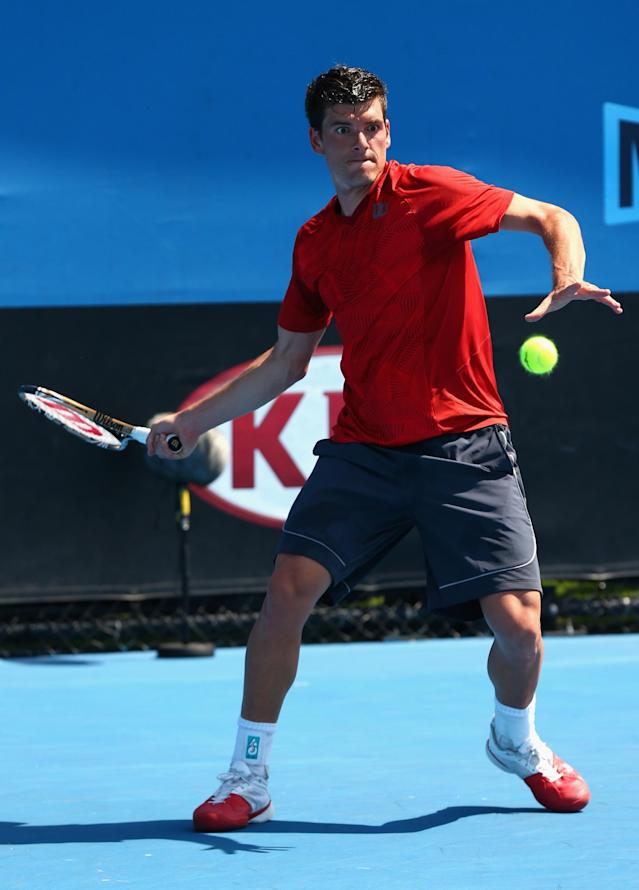 MELBOURNE, AUSTRALIA - JANUARY 14: Frank Dancevic of Canada plays a forehand in his first round match against Benoit Paire of France during day two of the 2014 Australian Open at Melbourne Park on January 14, 2014 in Melbourne, Australia. (Photo by Robert Prezioso/Getty Images)