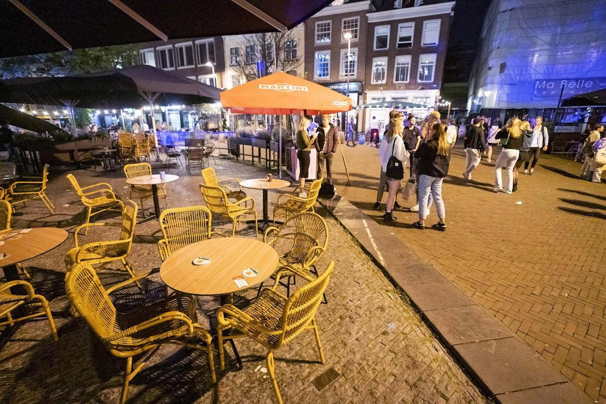 People leave cafes and restaurants at midnight on July 10, 2021 in Utrecht, at the start of the newly implemented curfew in the country in order to fight against the spread of the Covid-19. - Netherlands OUT (Photo by Jeroen JUMELET / ANP / AFP) / Netherlands OUT (Photo by JEROEN JUMELET/ANP/AFP via Getty Images)
