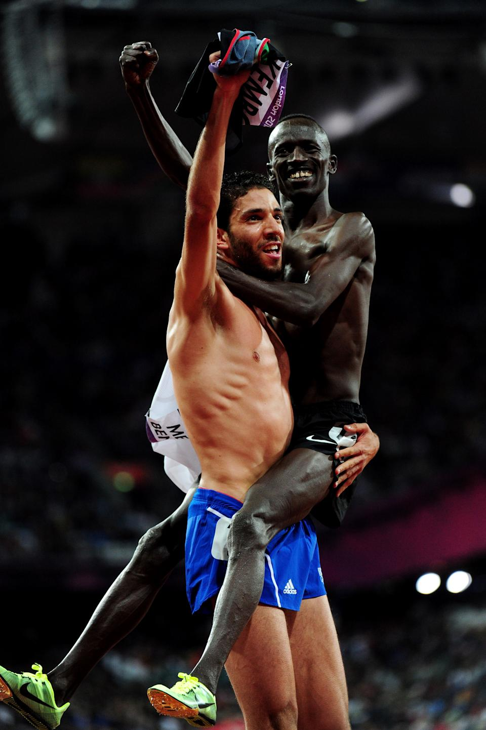 LONDON, ENGLAND - AUGUST 05: Silver medalist Mahiedine Mekhissi-Benabbad of France celebrates with gold medalist Ezekiel Kemboi of Kenya celebrate after the Men's 3000m Steeplechase on Day 9 of the London 2012 Olympic Games at the Olympic Stadium on August 5, 2012 in London, England. (Photo by Stu Forster/Getty Images)
