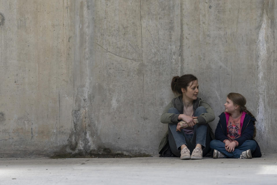 """This image released by Amazon Studios shows Clare Dunne, left, and Ruby Rose O'Hara in a scene from """"Herself,"""" available for streaming on Amazon Prime Video on Friday. (Pat Redmond/Amazon Studios via AP)"""