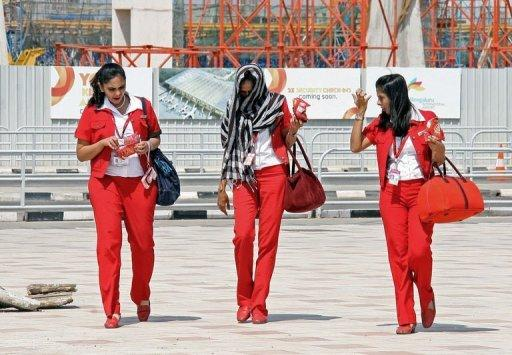 Air hostesses from India's Kingfisher Airlines leave Bangalore International Airport