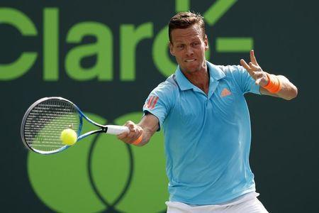 Mar 30, 2017; Miami, FL, USA; Tomas Berdych of the Czech Republic hits a forehand against Roger Federer of Switzerland (not pictured) in a men's singles quarter-final during the 2017 Miami Open at Crandon Park Tennis Center. Federer won 6-2, 3-6, 7-6(6). Mandatory Credit: Geoff Burke-USA TODAY Sports