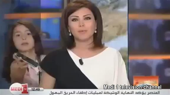 Not now, mummy's working! Newsreader's live report is interrupted by her own daughter