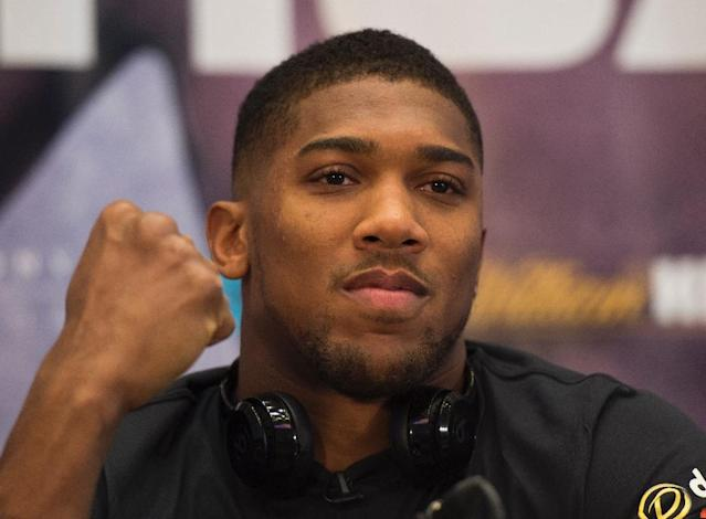 "Anthony Joshua says boxers struggle to adapt to mixed martial arts because they ""cannot handle the submissions"" (AFP Photo/DON EMMERT)"