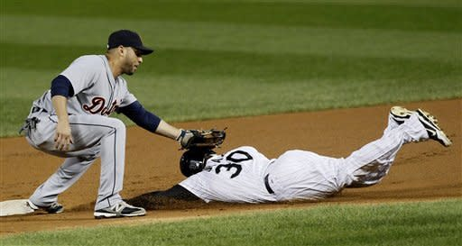 Detroit Tigers second baseman Omar Infante appears to tag Chicago White Sox's Alejandro De Aza (30) on the head but was called safe stealing second by umpire Todd Tichenor, during the first inning of a baseball game, Monday, Sept. 10, 2012, in Chicago. (AP Photo/Charles Rex Arbogast)