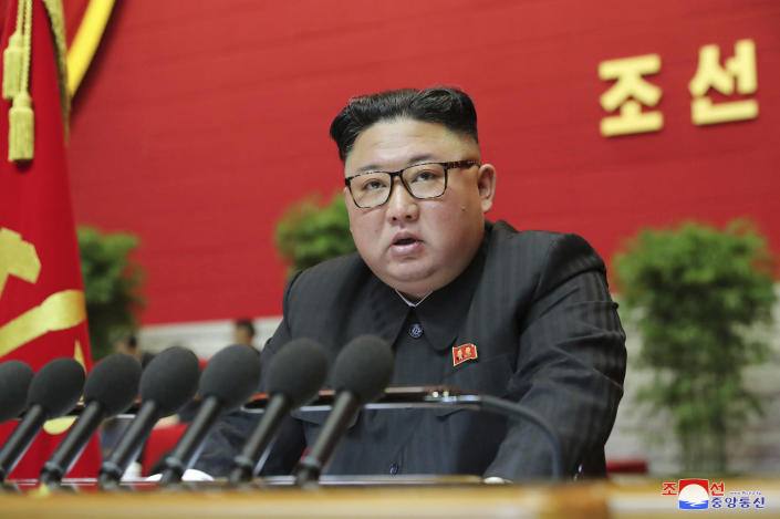 """In this photo provided by the North Korean government, North Korean leader Kim Jong Un speaks at the ruling party congress in Pyongyang, North Korean, Friday, Jan. 8, 2021. Kim threatened to expand his nuclear arsenal and develop more sophisticated weapons systems, saying the fate of relations with the United States depends on whether it abandons its hostile policy, state media reported Saturday. The congress, the Workers Party's top decision-making body, convened for the first time in five years. Independent journalists were not given access to cover the event depicted in this image distributed by the North Korean government. The content of this image is as provided and cannot be independently verified. Korean language watermark on image as provided by source reads: """"KCNA"""" which is the abbreviation for Korean Central News Agency. (Korean Central News Agency/Korea News Service via AP)"""