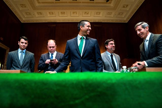 Ajit Pai (center), president of the FCC. EFE/JIM LO SCALZO