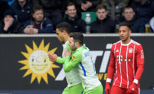 Soccer Football - Bundesliga - VfL Wolfsburg vs Bayern Munich - Volkswagen Arena, Wolfsburg, Germany - February 17, 2018 Wolfsburg's Daniel Didavi celebrates scoring their first goal with Renato Steffen as Bayern Munich's Corentin Tolisso looks dejected REUTERS/Fabian Bimmer DFL RULES TO LIMIT THE ONLINE USAGE DURING MATCH TIME TO 15 PICTURES PER GAME. IMAGE SEQUENCES TO SIMULATE VIDEO IS NOT ALLOWED AT ANY TIME. FOR FURTHER QUERIES PLEASE CONTACT DFL DIRECTLY AT + 49 69 650050