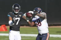 Chicago Bears linebacker Roquan Smith (58) intercepts a pass intended for Jacksonville Jaguars wide receiver DJ Chark Jr. (17) during the first half of an NFL football game, Sunday, Dec. 27, 2020, in Jacksonville, Fla. (AP Photo/Stephen B. Morton)