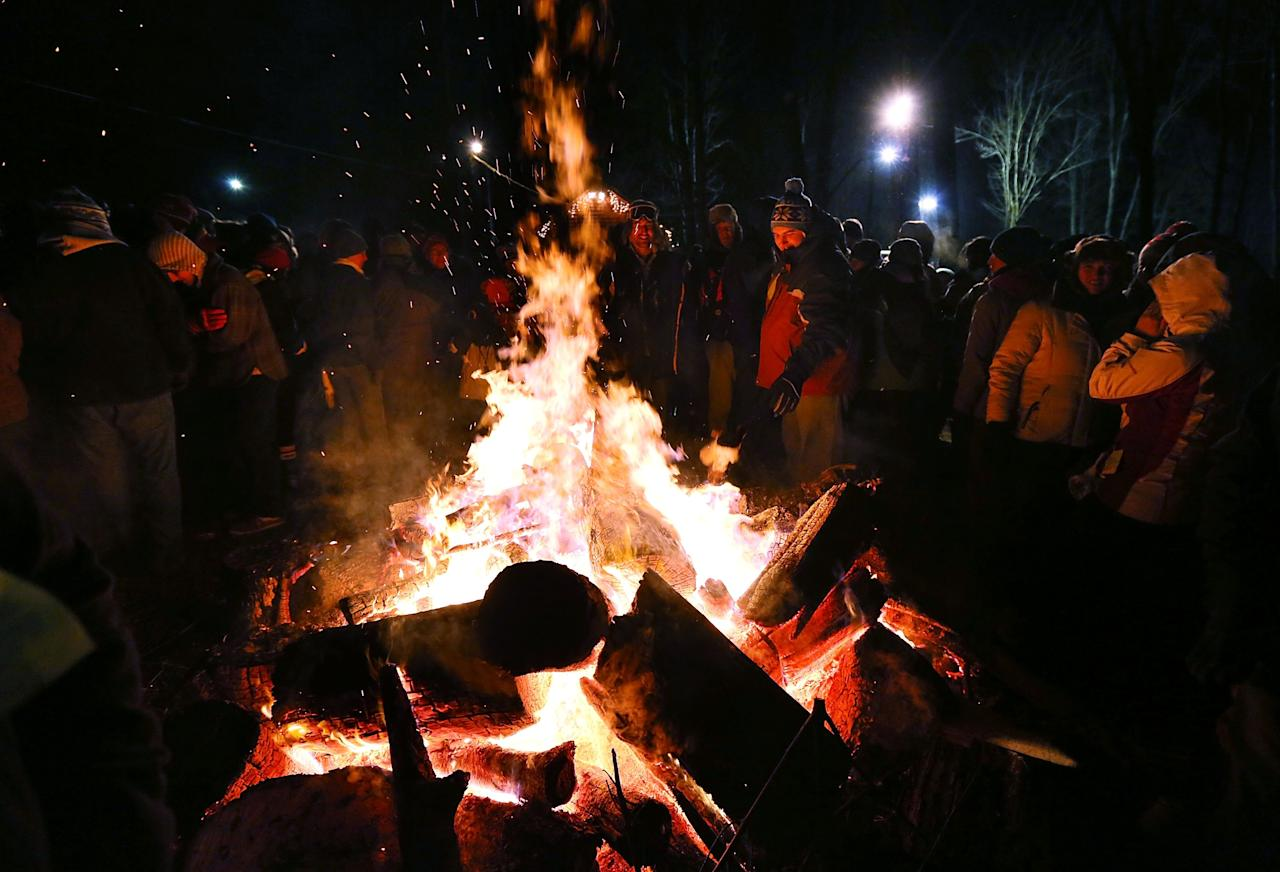 PUNXSUTAWNEY, PA - FEBRUARY 02: A crowd surround a fire to keep themselves warm during the 127th Groundhog Day Celebration at Gobbler's Knob on February 2, 2013 in Punxsutawney, Pennsylvania. Thousands of people gathered at the event to watch Phil's annual forecast.  (Photo by Alex Wong/Getty Images)