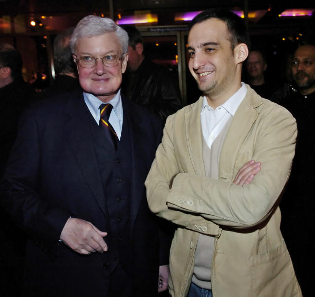 """Film critic Roger Ebert, left, and Alejandro Amenabar of Spain, director of the Oscar-nominated foreign language film """"The Sea Inside,"""" pose at a reception for the Best Foreign Language Film nominees, at the Academy of Motion Picture Arts and Sciences in Beverly Hills, Calif, Friday, Feb. 25, 2005. (AP Photo/Chris Pizzello)"""