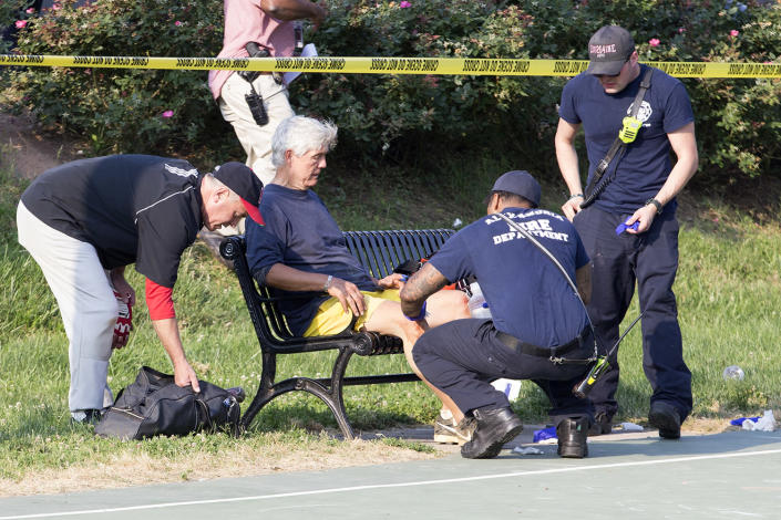 <p>A man receives medical attention from first responders on the scene following a shooting in Alexandria, Va, June 14, 2017. (Photo: Shawn Thew/EPA) </p>