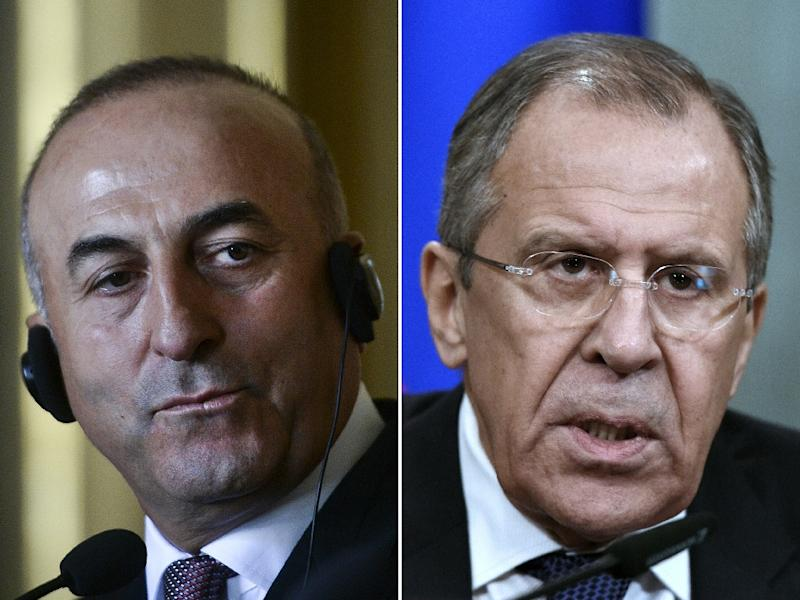 Turkish foreign minister Mevlut Cavusoglu (L) and Russian Foreign Minister Sergei Lavrov are set to meet over Ankara's downing of a Russian plane on November 24