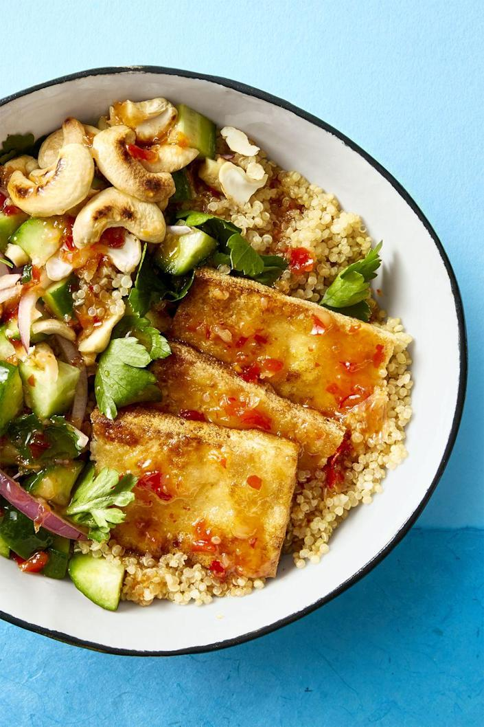 """<p>Whether you're a vegan or not, this bowl, loaded with quinoa, roasted cashews, and crispy tofu, is sure to please.</p><p><em><a href=""""https://www.goodhousekeeping.com/food-recipes/easy/a45226/crispy-tofu-bowl-recipe"""" rel=""""nofollow noopener"""" target=""""_blank"""" data-ylk=""""slk:Get the recipe for Crispy Tofu Bowl »"""" class=""""link rapid-noclick-resp"""">Get the recipe for Crispy Tofu Bowl »</a></em></p><p><strong>RELATED:</strong> <a href=""""https://www.goodhousekeeping.com/food-recipes/healthy/g807/vegan-recipes/"""" rel=""""nofollow noopener"""" target=""""_blank"""" data-ylk=""""slk:54 Vegan Recipes so Good, You'll Forget About Meat and Cheese"""" class=""""link rapid-noclick-resp"""">54 Vegan Recipes so Good, You'll Forget About Meat and Cheese</a></p>"""