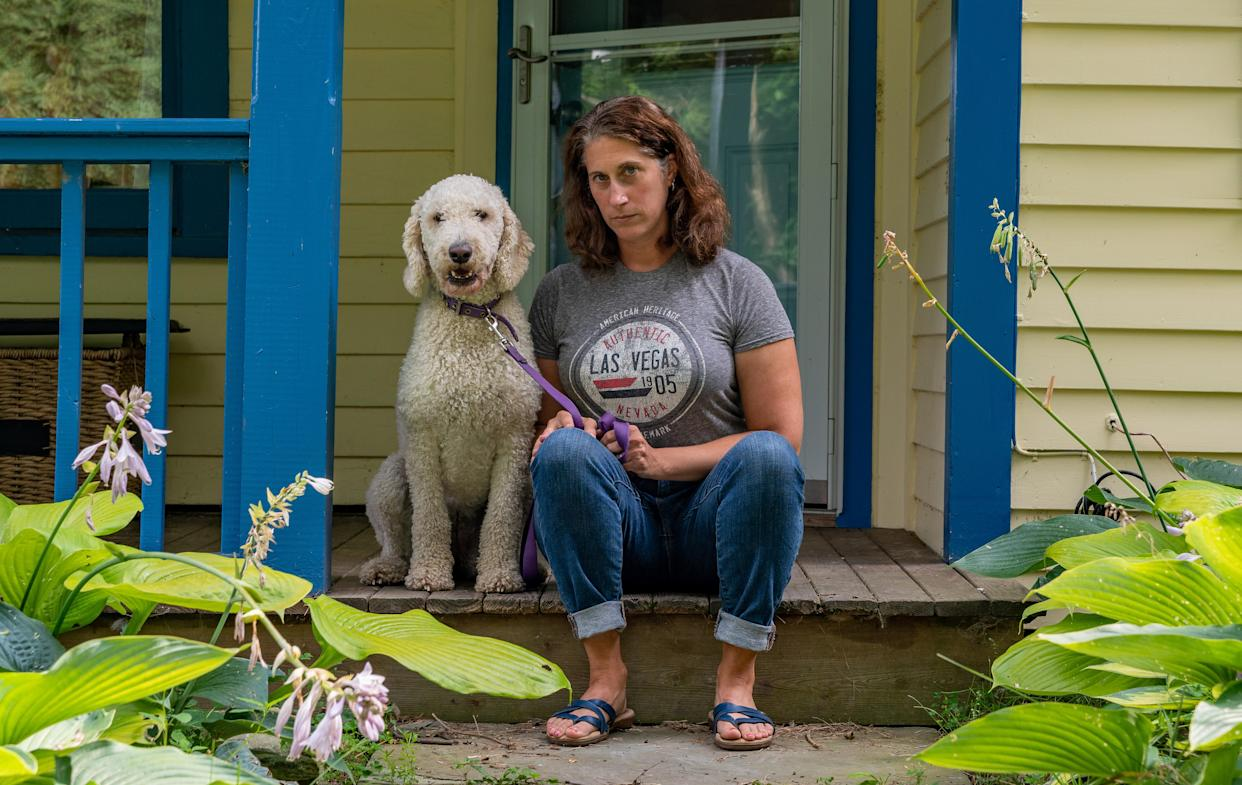 """Kami Lewis Levin and her dog, Abby, in Canaan, N.Y. Levin and her family are leaving the United States for Costa Rica due to the political climate in the U.S. (Photo: David """"Dee"""" Delgado for Yahoo News)"""