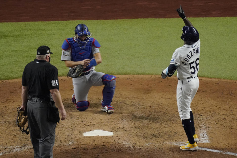 Tampa Bay Rays' Randy Arozarena celebrates home run during the ninth inning in Game 3 of the baseball World Series against the Los Angeles Dodgers Friday, Oct. 23, 2020, in Arlington, Texas. Dodgers beat the Rays 6-2 to lead the series 2-1 games. (AP Photo/Sue Ogrocki)