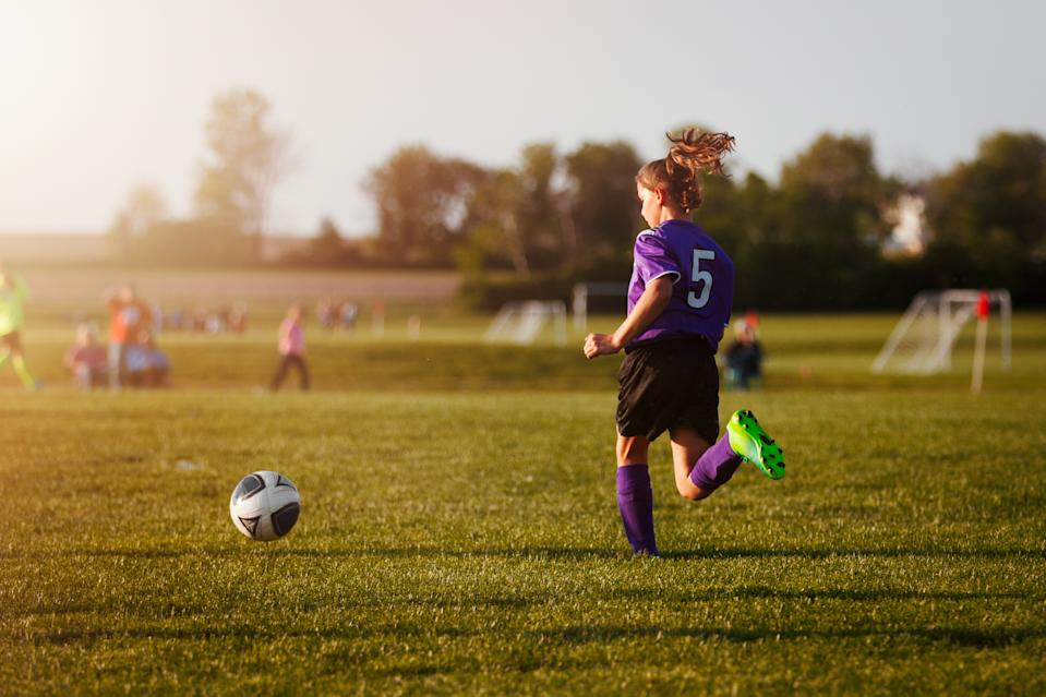 girl playing in soccer game