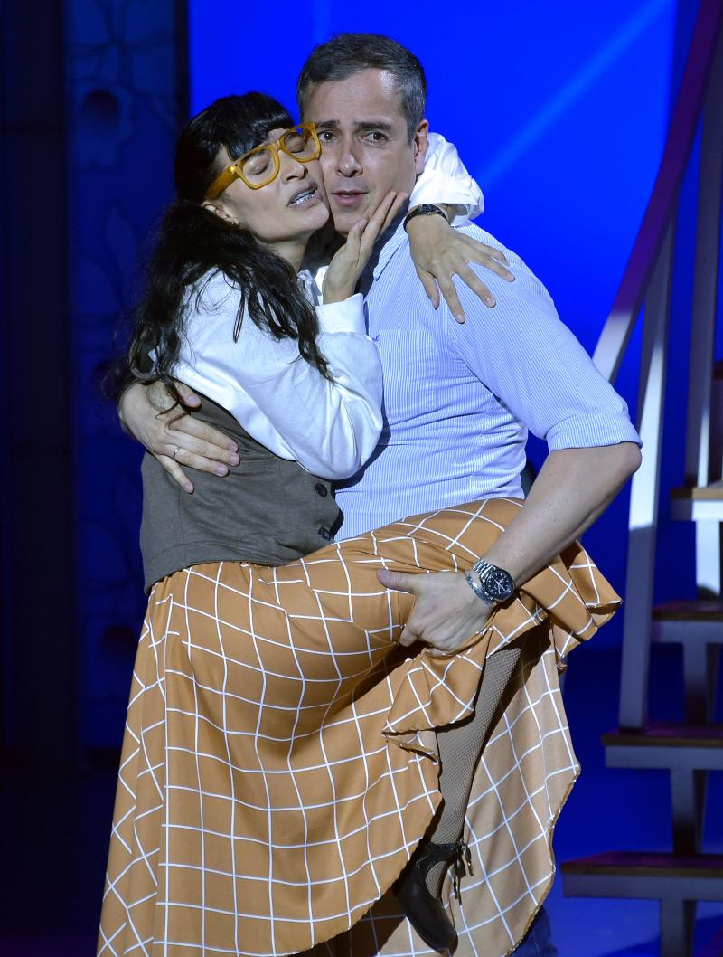 "Colombian actors Ana Maria Orozco (L) and Jorge Abello perform during a rehearsal of the play ""I'm Betty the ugly"" in Bogota on March 30, 2017. Ugly Betty's thick glasses, annoying voice and noble heart, return in a theatrical version that opens Thursday in Bogota, featuring the original cast that gave life to the most successful soap opera in history. / AFP PHOTO / Guillermo LEGARIA (Photo credit should read GUILLERMO LEGARIA/AFP via Getty Images)"