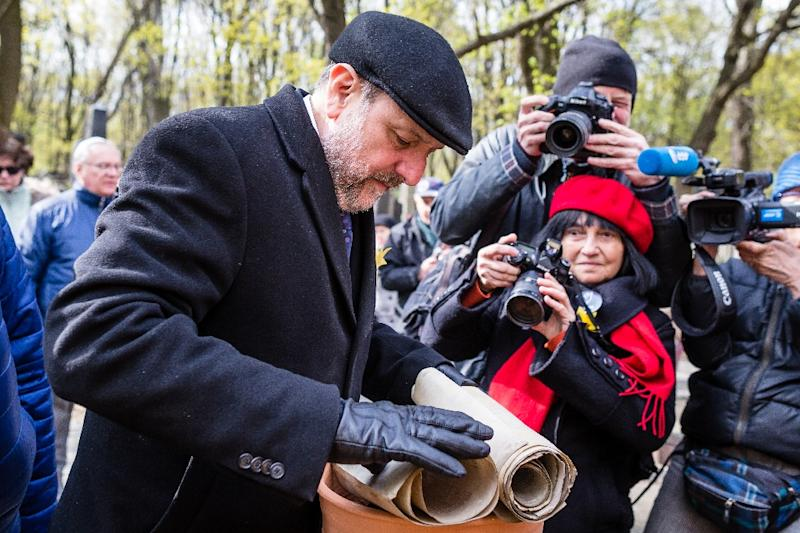 Polish Chief Rabbi Michael Schudrich prepares broken Torah scrolls for a burial ceremony in Warsaw