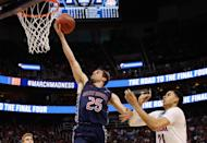 <p>Joe Rahon (25) of St. Mary's lays the ball up around Chance Comanche (21) of Arizona during the 2017 NCAA Men's Basketball Tournament held at Vivint Smart Home Arena on March 18, 2017 in Salt Lake City, Utah. (Photo by Jack Dempsey/NCAA Photos via Getty Images) </p>